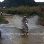 Vietnam motorbike tours, Vietnam motorcycle tours. Crossing a Northwest stream